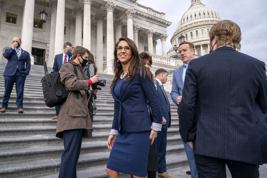 Rep. Lauren Boebert, R-Colo., center, smiles after joining other freshman Republican House members for a group photo at the Capitol in Washington, Monday, Jan. 4, 2021. (AP Photo/J. Scott Applewhite)