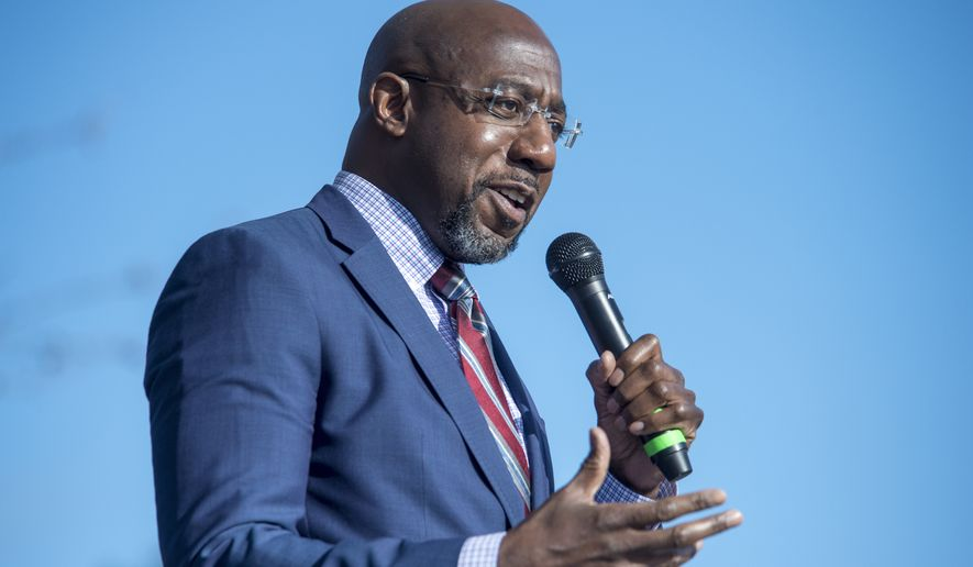Georgia Democratic senate candidate Raphael Warnock speaks during a campaign rally in Augusta, Ga., Monday, Jan. 4, 2021. Democrats Jon Ossoff and Warnock are challenging incumbent Republican Senators David Perdue and Kelly Loeffler in a runoff election on Jan. 5. (Michael Holahan/The Augusta Chronicle via AP)