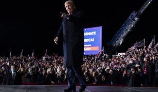 President Donald Trump arrives to speak at a campaign rally for Sen. Kelly Loeffler, R-Ga., and David Perdue at Dalton Regional Airport, Monday, Jan. 4, 2021, in Dalton, Ga. (AP Photo/Evan Vucci)