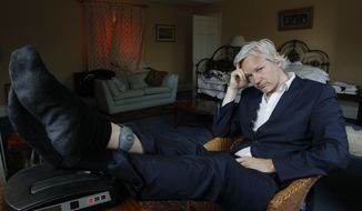 In this Wednesday, June 15, 2011, file photo, WikiLeaks founder Julian Assange is seen with his ankle security tag at the house where he is required to stay, near Bungay, England. Judge Vanessa Baraitser has ruled that Julian Assange cannot be extradited to the US. because of concerns about his mental health, it was reported on Monday, Jan. 4, 2021. (AP Photo/Kirsty Wigglesworth, File)