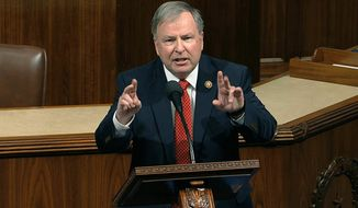 FILE - In this Dec. 18, 2019, file photo, Rep. Doug Lamborn, R-Colo., speaks at the Capitol in Washington. Lamborn on Monday, Jan. 4, 2021, joined the state's newest member of Congress, Republican Lauren Boebert, in saying he will vote against certifying Democrat Joe Biden's presidential election victory in a joint session of Congress on Wednesday, Jan. 6. (House Television via AP, File)