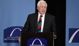 """FILE -  In this May 5, 2017 file photo, former U.S. Sen. John Danforth speaks at the Bar Association of Metropolitan St. Louis in St. Louis. Danforth is critical of efforts by Sen. Josh Hawley, of Missouri, and others in Congress to challenge Democrat Joe Biden's election win. Danforth, a former three-term senator from Missouri, called the effort a """"highly destructive attack on our constitutional government."""" Danforth has previously been a long-time supporter of Hawley, backing his successful runs for Missouri attorney general in 2016 and the U.S. Senate in 2018. (AP Photo/Jeff Roberson, File)"""
