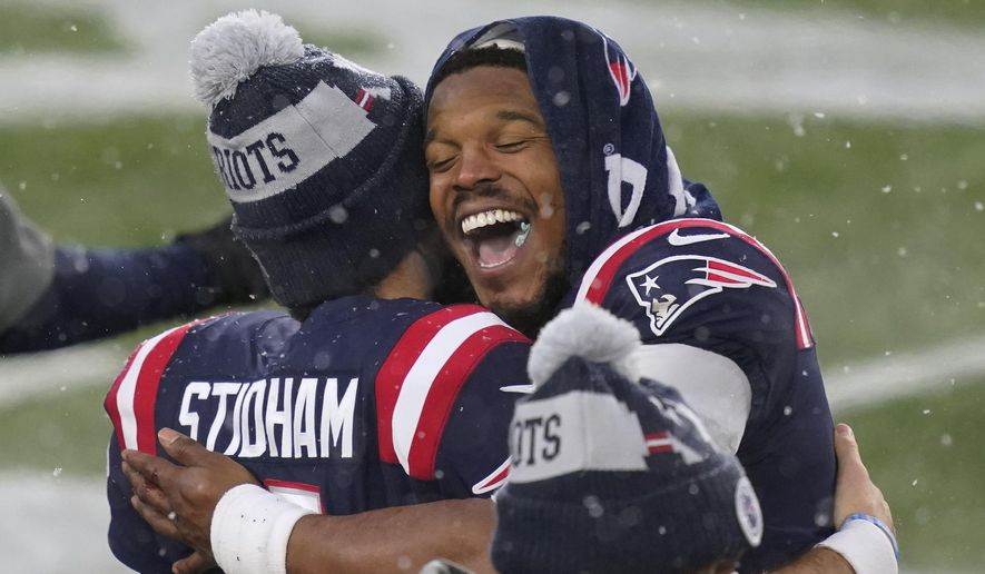 New England Patriots quarterbacks Jarrett Stidham, left, and Cam Newton embrace on the sideline at the end of an NFL football game against the New York Jets, Sunday, Jan. 3, 2021, in Foxborough, Mass. (AP Photo/Elise Amendola)