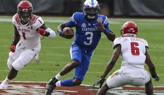 Kentucky quarterback Terry Wilson (3) runs the ball against North Carolina State during the first half of an NCAA college football game in Jacksonville, Fla., Saturday, Jan. 2, 2021. (Gary Lloyd McCullough/The Florida Times-Union via AP)