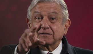 """Mexican President Andres Manuel Lopez Obrador gives his regularly scheduled morning press conference known as """"La Mañanera"""" at the National Palace in Mexico City, Friday, Dec. 18, 2020. Las Mañaneras are a platform for the president to relay information he says the media ignore or misrepresent. (AP Photo/Marco Ugarte)"""
