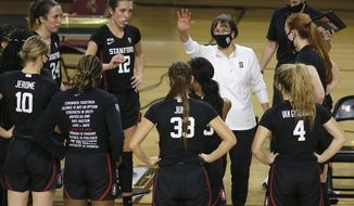 Stanford head coach Tara Vanderveer talks to her team as they play Arizona State during the second half of an NCAA college basketball game Sunday, Jan 3, 2021, in Tempe, Ariz. (AP Photo/Darryl Webb)