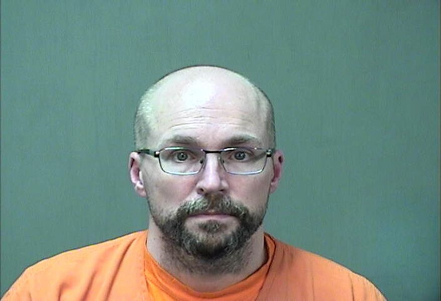 """In this booking photo provided by the Ozaukee County Sheriff's Office Monday, Jan. 4, 2021 in Port Washington, Wis. Steven Brandenburg is shown. The Wisconsin pharmacist, accused of intentionally spoiling hundreds of doses of coronavirus vaccine, convinced the world was """"crashing down"""" told police he tried to ruin hundreds of doses of coronavirus vaccine because he felt the shots would mutate people's DNA, according to court documents released Monday. (Ozaukee County Sheriff via AP)"""