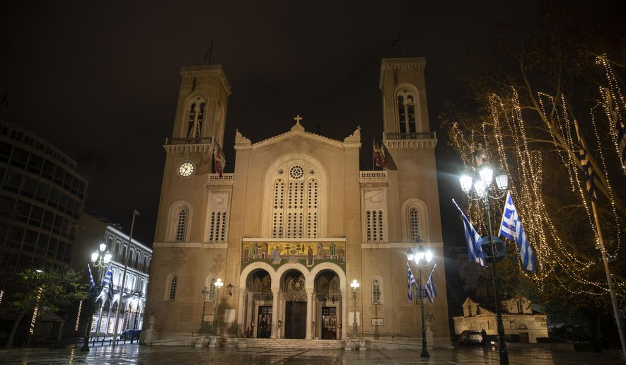 The Athens Orthodox Cathedral, in Athens, on Monday Jan. 4, 2021. Greece's powerful Orthodox Church is rebelling against a government order to briefly close places of worship under a weeklong drive to tighten virus restrictions ahead of the planned reopening of schools. (AP Photo/Petros Giannakouris)