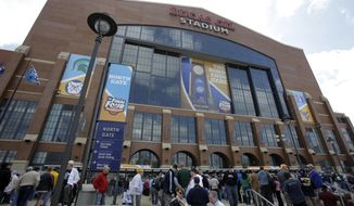 FILE - Fans arrive at Lucas Oil Stadium before a men's NCAA Final Four semifinal college basketball game between Butler and Michigan State in Indianapolis, in this April 3, 2010, file photo. The NCAA announced Monday, Jan. 4, 2021, that all 67 men's basketball tournament games including the Final Four will be played entirely in Indiana in a bid to keep the marquee event from being called off for a second consecutive year because of the coronavirus pandemic. Games will be played on two courts inside Lucas Oil Stadium as well as at Bankers Life Fieldhouse, Hinkle Fieldhouse, Indiana Farmers Coliseum, Mackey Arena at Purdue and Assembly Hall in Bloomington. Only one game at a time will be played at Lucas Oil Stadium.. (AP Photo/Amy Sancetta, File)