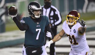 Philadelphia Eagles' Nate Sudfeld (7) passes against Washington Football Team's Ryan Kerrigan (91) during the second half of an NFL football game, Sunday, Jan. 3, 2021, in Philadelphia. (AP Photo/Derik Hamilton). **FILE**