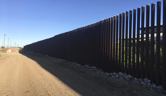 A border fence located in Columbus, New Mexico, provides a sharp demarcation between the United States and Mexico. (Associated Press)
