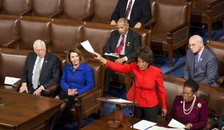 In this file photo, Rep. Maxine Waters, D-Calif., objects during a joint session of Congress to count electoral votes in Washington, Friday, Jan. 6, 2017. (AP Photo/Zach Gibson)  **FILE**