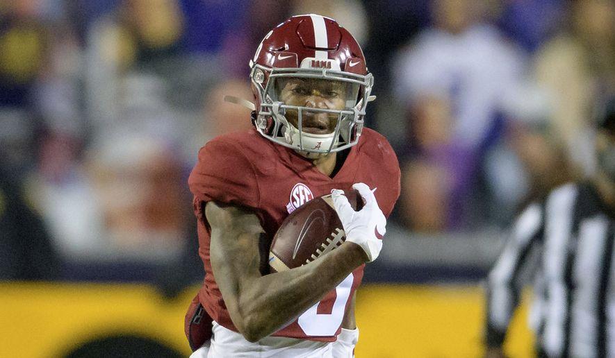 Alabama wide receiver DeVonta Smith (6) runs for gain during an NCAA college football game against LSU in Baton Rouge, La., Saturday, Dec. 5, 2020. (AP Photo/Matthew Hinton) **FILE**