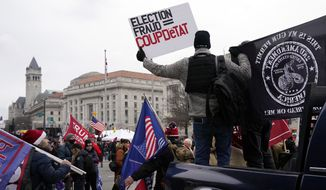 People attend a rally at Freedom Plaza Tuesday, Jan. 5, 2021, in Washington, in support of President Donald Trump. (AP Photo/Jacquelyn Martin)