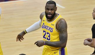 Los Angeles Lakers forward LeBron James (23) calls to teammates in the first half of an NBA basketball game against the Memphis Grizzlies Tuesday, Jan. 5, 2021, in Memphis, Tenn. (AP Photo/Brandon Dill)