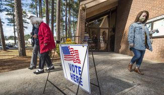 Voters leave the Warren Road Community Center after casting their ballots in Georgia's much anticipated runoff election in Augusta, Ga., Tuesday, Jan. 5, 2021. Republican Sen. Kelly Loeffler and David Perdue are being challenged by Democrats Jon Ossoff and Rafael Warnock in Tuesday's runoff. (Michael Holahan/The Augusta Chronicle via AP)