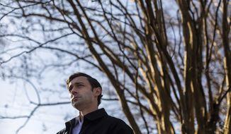 Democratic U.S. Senate challenger Jon Ossoff speaks to the media at Dunbar Neighborhood Center during Georgia's Senate runoff elections, Tuesday, Jan. 5, 2021, in Acworth, Ga. (AP Photo/Branden Camp)