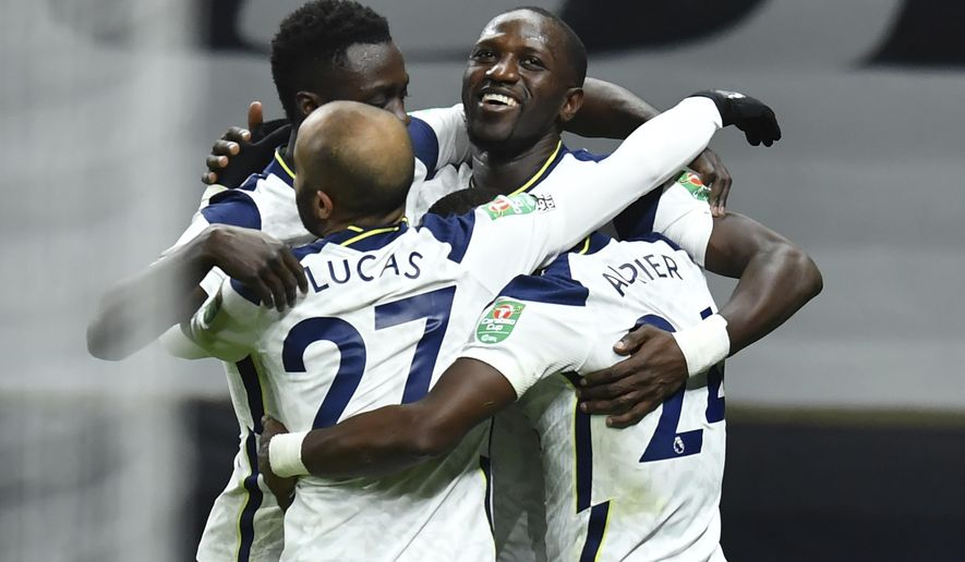 Tottenham's team players celebrate after Moussa Sissoko scored their side's first goal during the EFL Cup semi-final soccer match between between Tottenham Hotspur and Brentford at Tottenham Hotspur Stadium in London, England, Tuesday, Jan. 5, 2021. (Glyn Kirk/Pool via AP)