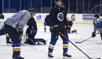 St. Louis Blues center Ryan O'Reilly (90) and Blues defenseman Robert Bortuzzo (41) joke around after NHL hockey practice at the Centene Community Ice Center in Maryland Heights, Mo., Monday, Jan. 4, 2021.  (Colter Peterson/St. Louis Post-Dispatch via AP)