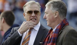 """FILE - In this Sunday, Jan. 1, 2017 file photo, Denver Broncos general manager John Elway, left, stands with Broncos President and CEO Joe Ellis, right, before an NFL football game against the Oakland Raiders in Denver. The Denver Broncos' new general manager will join an organization embroiled in a family ownership feud and will work in the shadow of John Elway, whom team president Joe Ellis described as """"the most important and impactful person"""" in franchise history.(AP Photo/Jack Dempsey, File)"""
