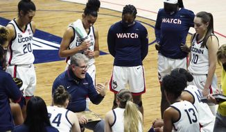 Connecticut coach Geno Auriemma talks to his team during a timeout in the first half against DePaul in an NCAA college basketball game Tuesday, Dec. 29, 2020, in Storrs, Conn. (David Butler II/Pool Photo via AP)