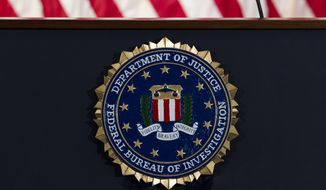 In this June 14, 2018, file photo, the FBI seal is seen before a news conference at FBI headquarters in Washington. (AP Photo/Jose Luis Magana, File)  **FILE**