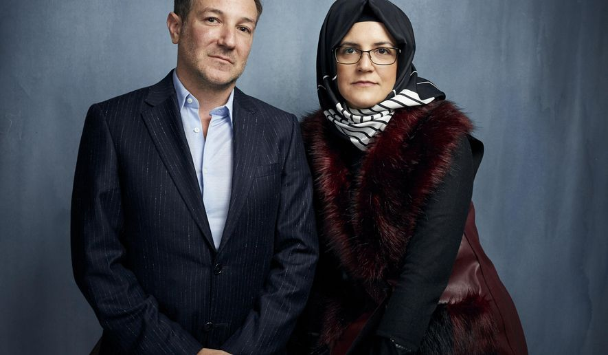 "FILE - Director Bryan Fogel, left, and  Hatice Cengiz pose for a portrait to promote ""The Dissident,"" a film about slain journalist Jamal Khashoggi, during the Sundance Film Festival  in Park City, Utah on Jan. 24, 2020. (Photo by Taylor Jewell/Invision/AP, File)"