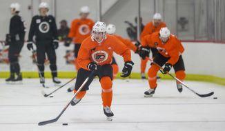 Philadelphia Flyers left wing Oskar Lindblom skates with the puck during NHL hockey practice, Monday, Jan. 4, 2021, in Voorhees, N.J. (Yong Kim/The Philadelphia Inquirer via AP)