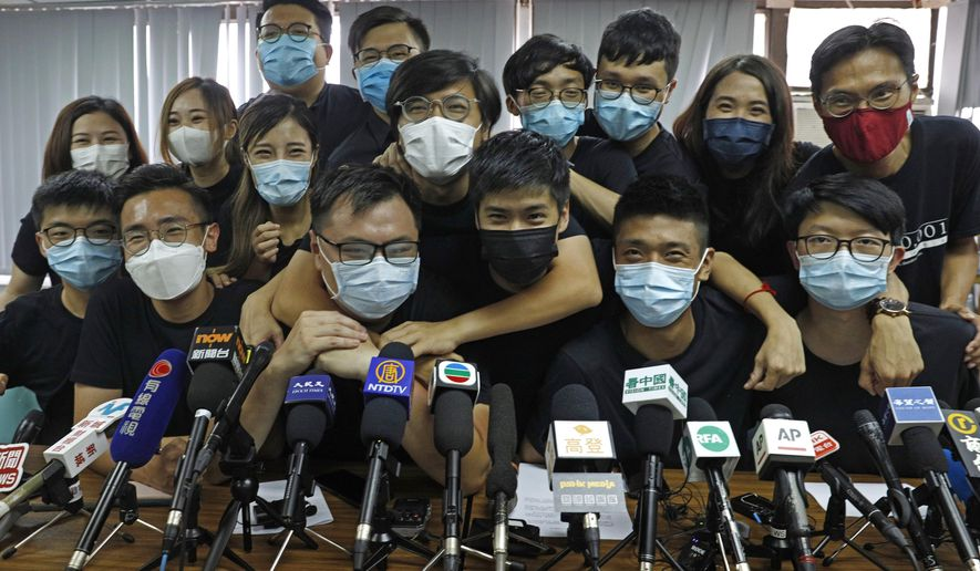 In this July 15, 2020, file photo, pro-democracy activists who were elected from unofficial pro-democracy primaries, including Joshua Wong, left, attend a press conference in Hong Kong. About 50 Hong Kong pro-democracy figures were arrested by police on Wednesday, Jan. 6, 2021, under a national security law, following their involvement in an unofficial primary election last year held to increase their chances of controlling the legislature, according to local media reports. (AP Photo/Kin Cheung, File)
