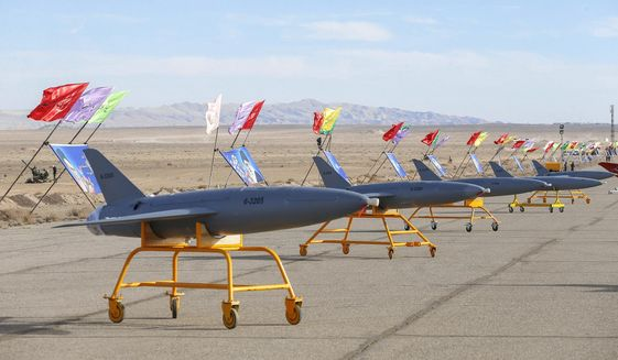 In this photo released on Tuesday, Jan. 5, 2021, by the Iranian army, drones are displayed prior to a drill, in an undisclosed location in Iran. The Iranian military began a wide-ranging, two-day aerial rill in the country's north, state media reported, featuring combat and surveillance unmanned aircraft, as well as naval drones dispatched from vessels in Iran's southern waters. (Iranian Army via AP) ** FILE **