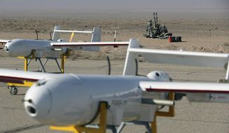In this undated photo released on Monday, Jan. 4, 2021, by Iranian Army, drones are displayed ahead of a drill, Iran. The Iranian military on Tuesday, Jan. 5. 2021 began a wide-ranging, two-day aerial drill in the country's north, state media reported, featuring combat and surveillance unmanned aircraft, as well as naval drones dispatched from vessels in Iran's southern waters. (Iranian Army via AP)