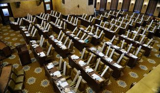A box containing a new umbrella is placed on each lawmaker's seat in the House during the first day of the 2021 Mississippi Legislature, Tuesday, Jan. 5, 2021, in Jackson, Miss.  (AP Photo/Rogelio V. Solis)