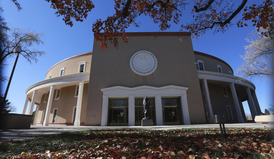 Leaves turn red outside the New Mexico State Capitol building, known as the Roundhouse, Tuesday, Nov. 17, 2020, in Santa Fe, N.M. (AP Photo/Cedar Attanasio)