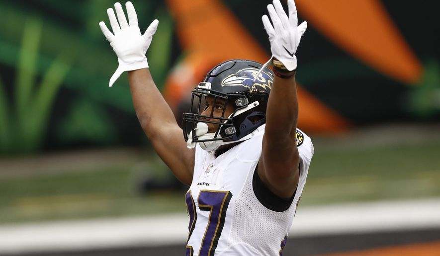 Baltimore Ravens running back J.K. Dobbins (27) celebrates after scoring a touchdown against the Cincinnati Bengals during the second half of an NFL football game, Sunday, Jan. 3, 2021, in Cincinnati. (AP Photo/Aaron Doster) **FILE**