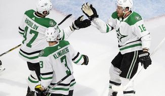 FILE - Dallas Stars' Alexander Radulov (47), John Klingberg (3) and Joe Pavelski (16) celebrate a goal against the Colorado Avalanche during the second period of an NHL hockey Western Conference playoff game in Edmonton, Alberta, in this Monday, Aug. 24, 2020, file photo. The Dallas Stars feel like they have something to prove after falling short in the Stanley Cup Final last season. The relish the opportunity for a better start this season and carry over the success they had in the NHL bubble. (Jason Franson/The Canadian Press via AP, File)