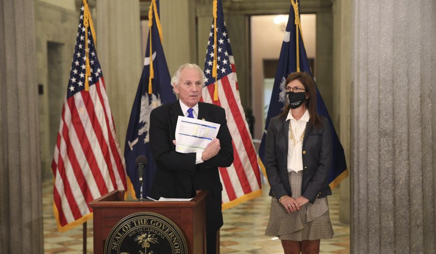 South Carolina Gov. Henry McMaster shows a listing of hospitals in the state that have received the COVID-19 vaccine during a news conference at the Statehouse in Columbia, South Carolina, on Tuesday, Jan. 5, 2021. McMaster wants health officials to set a Jan. 15 deadline to get vaccines before they open them to frontline workers and people over age 75. (AP Photo/Jeffrey Collins) **FILE**