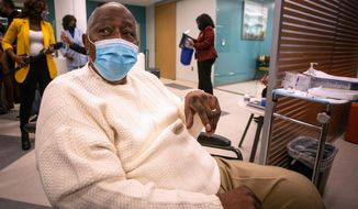 Baseball Hall of Famer Hank Aaron waits to receive his COVID-19 vaccination on Tuesday, Jan. 5, 2021, at the Morehouse School of Medicine in Atlanta. Aaron and others received their vaccinations in an effort to highlight the importance of getting vaccinated for Black Americans who might be hesitant to do so. (AP Photo/Ron Harris)