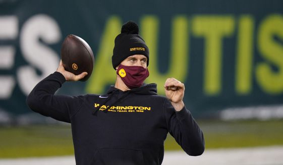 Washington Football Team's Alex Smith warms up before an NFL football game against the Philadelphia Eagles, Sunday, Jan. 3, 2021, in Philadelphia. (AP Photo/Chris Szagola) **FILE**