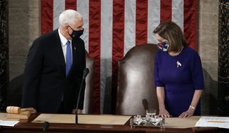 Speaker of the House Nancy Pelosi, D-Calif., and Vice President Mike Pence arrive to officiate as a joint session of the House and Senate convenes to count the Electoral College votes cast in November's election, at the Capitol in Washington, Wednesday, Jan. 6, 2021. (AP Photo/J. Scott Applewhite)