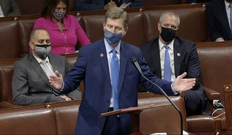 In this image from video, Rep. Greg Stanton, D-Ariz., speaks as the House reconvenes to debate the objection to confirm the Electoral College vote from Arizona, after protesters stormed into the U.S. Capitol on Wednesday, Jan. 6, 2021. (House Television via AP)