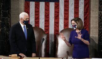 Speaker of the House Nancy Pelosi, D-Calif., and Vice President Mike Pence talk before a joint session of the House and Senate convenes to confirm the Electoral College votes cast in November's election, at the Capitol in Washington, Wednesday, Jan. 6, 2021. (AP Photo/J. Scott Applewhite, Pool)