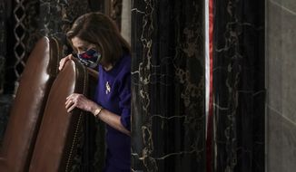 Speaker of the House Nancy Pelosi, D-Calif., calls the House in order prior to a joint session of the House and Senate convenes to confirm the Electoral College votes cast in November's election, at the Capitol in Washington, Wednesday, Jan. 6, 2021. (Greg Nash/Pool via AP)