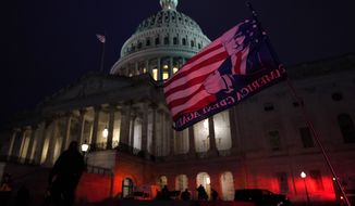 Authorities stand guard outside the U.S. Capitol after supporters of President Donald Trump gathered Wednesday, Jan. 6, 2021, in Washington. (AP Photo/Jacquelyn Martin)