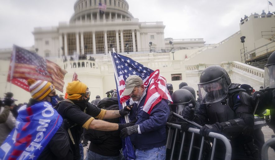 Trump supporters try to break through a police barrier, Wednesday, Jan. 6, 2021, at the Capitol in Washington. As Congress prepares to affirm President-elect Joe Biden's victory, thousands of people have gathered to show their support for President Donald Trump and his claims of election fraud. (AP Photo/John Minchillo) **FILE**