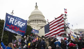 Supporters of President Donald Trump stand outside the U.S. Capitol on Wednesday, Jan. 6, 2021, in Washington. (AP Photo/Jose Luis Magana)