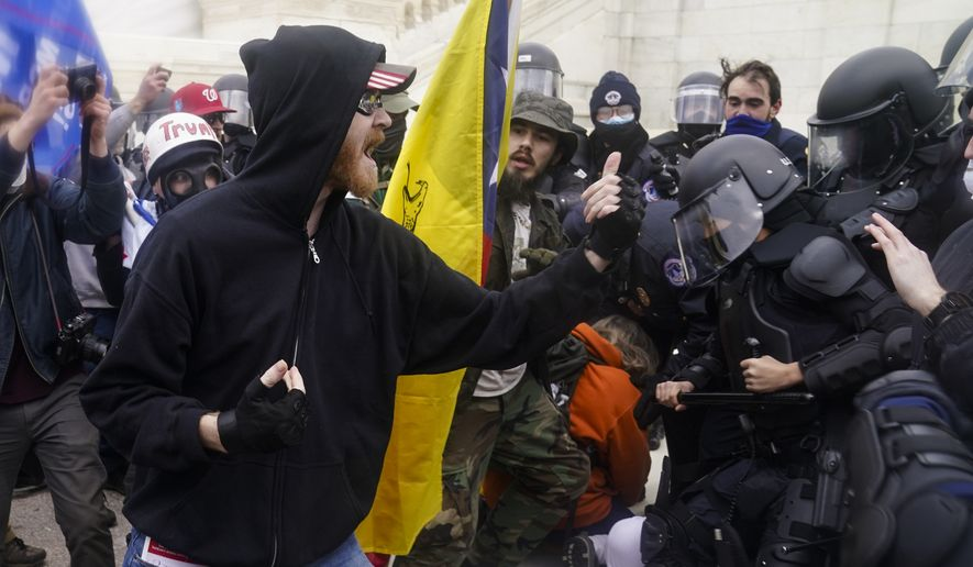 Trump supporters try to break through a police barrier, Wednesday, Jan. 6, 2021, at the Capitol in Washington. As Congress prepares to affirm President-elect Joe Biden's victory, thousands of people have gathered to show their support for President Donald Trump and his claims of election fraud. (AP Photo/John Minchillo)