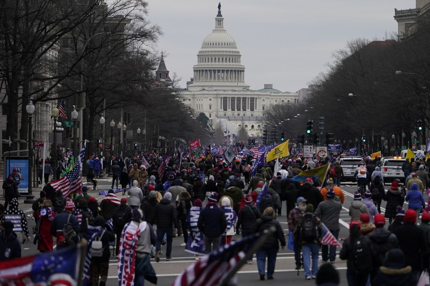 Supporters of President Donald Trump march on Pennsylvania Avenue towards the U.S. Capitol, Wednesday, Jan. 6, 2021, in Washington. (AP Photo/Jacquelyn Martin)