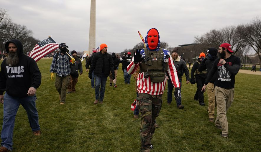 People march with those who say they are members of the Proud Boys as they attend a rally in Washington, Wednesday, Jan. 6, 2021, in support of President Donald Trump. (AP Photo/Carolyn Kaster)