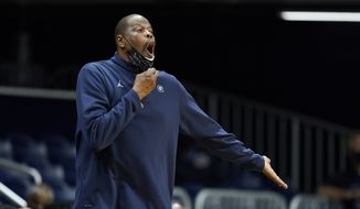 Georgetown head coach Patrick Ewing shouts during the second half of an NCAA college basketball game against Butler, Wednesday, Jan. 6, 2021, in Indianapolis. Butler won 63-55. (AP Photo/Darron Cummings) **FILE**