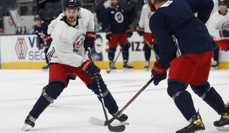 Columbus Blue Jackets' Oliver Bjorkstrand, of Denmark, looks for the puck during an NHL hockey training camp practice Tuesday, Jan. 5, 2021, in Columbus, Ohio. (AP Photo/Jay LaPrete)